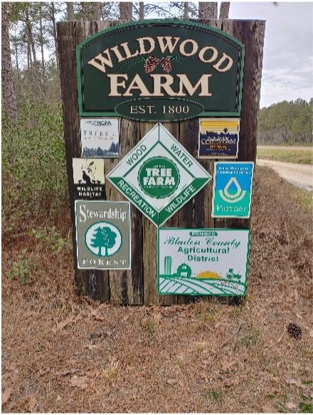 "A sign reading ""Wildwood Farm: EST. 1800"""