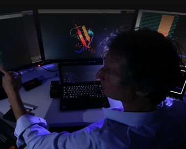 scientist working on a computer
