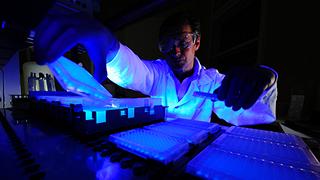 scientist working under blacklight
