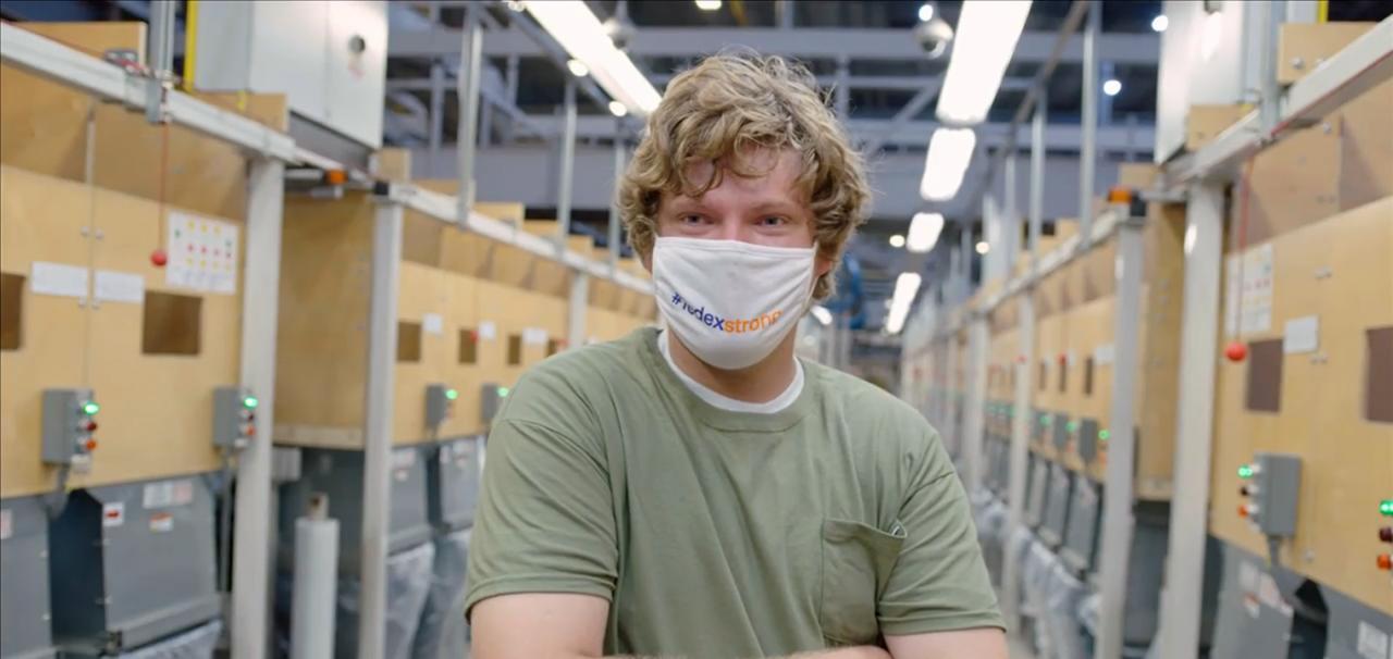 FedEx employee wearing mask