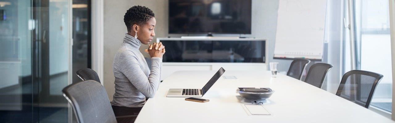 Black woman working on a computer in an office