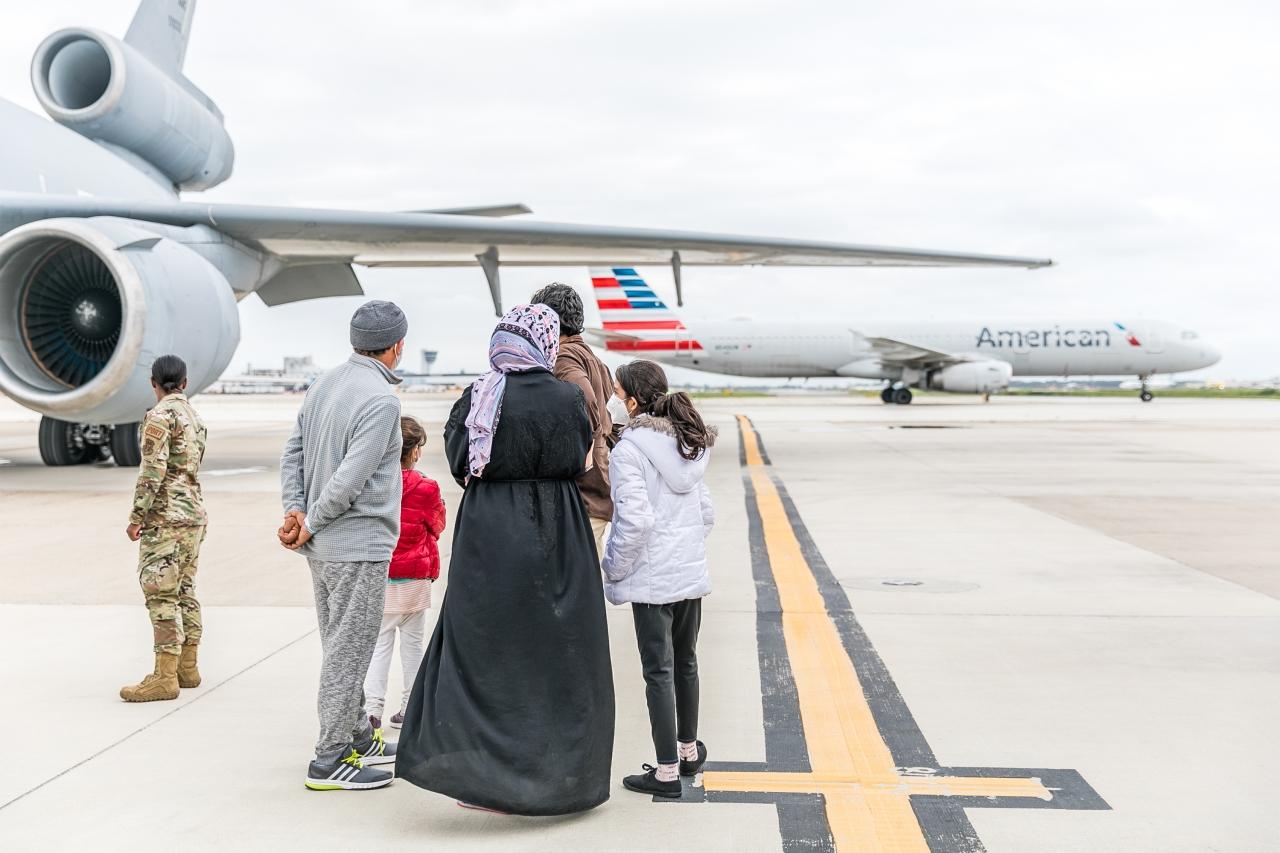 Family standing near plane