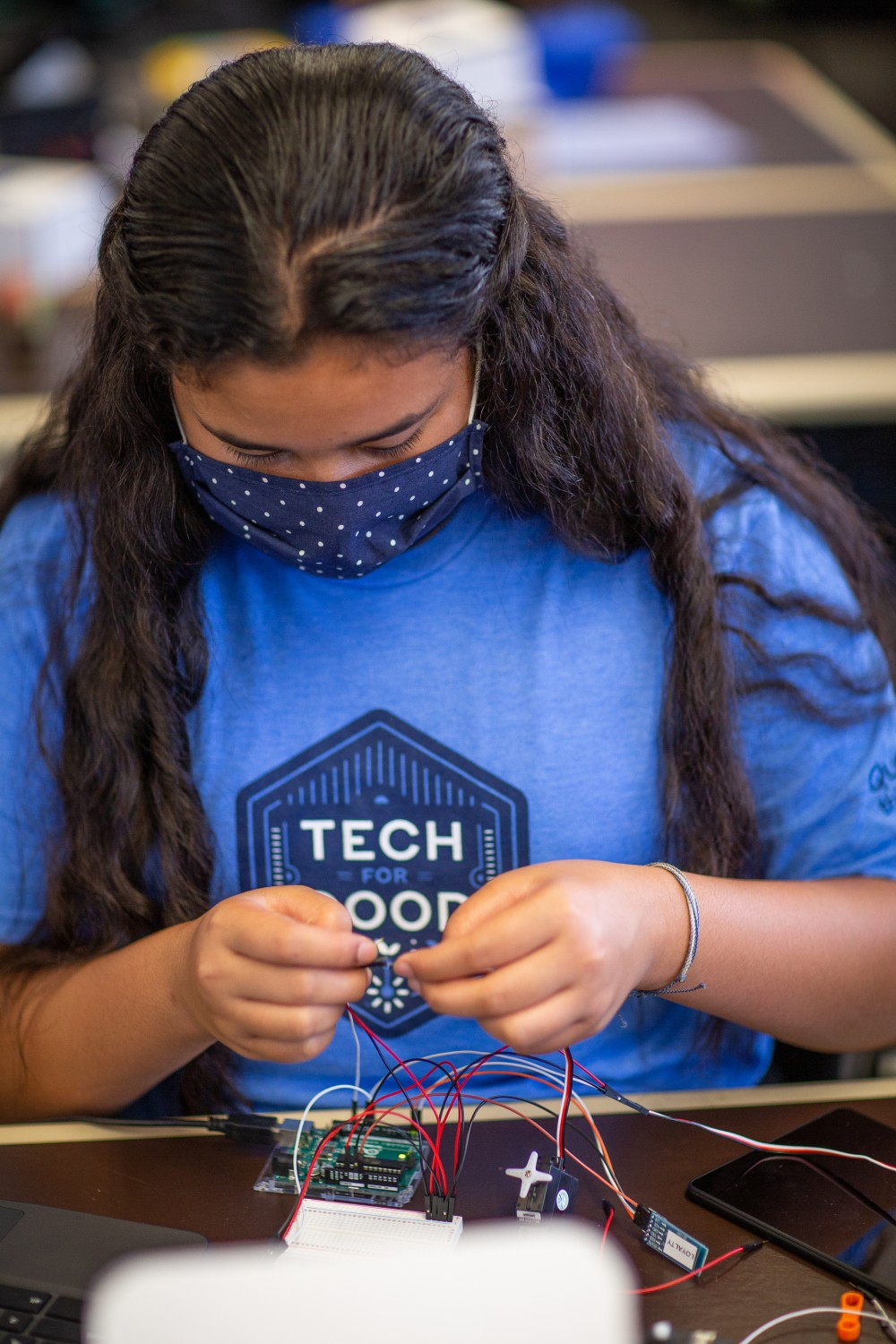 child working on a technology project