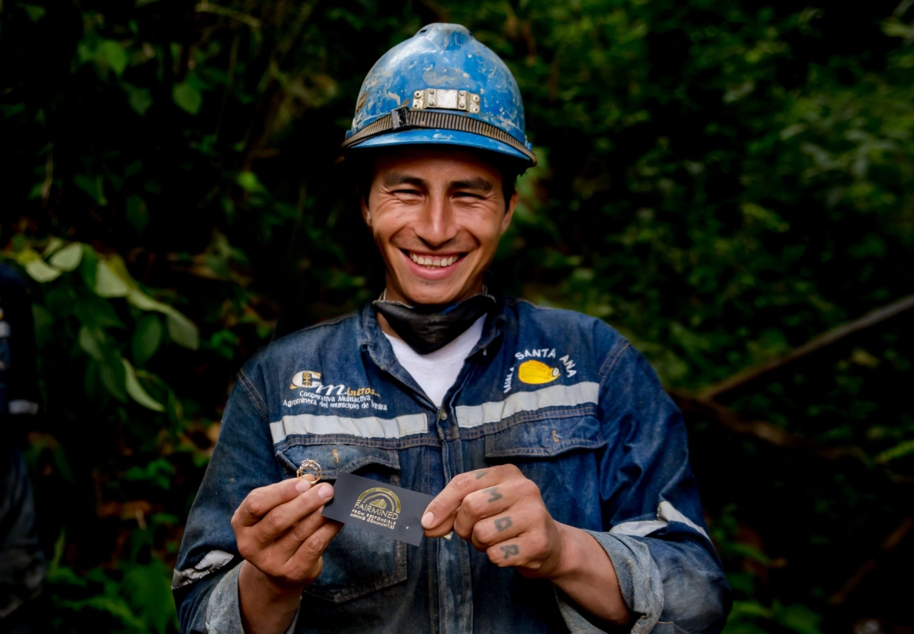 An Alliance for Responsible Mining Member Holding a Fairmined Card. Photo: Fairmined.