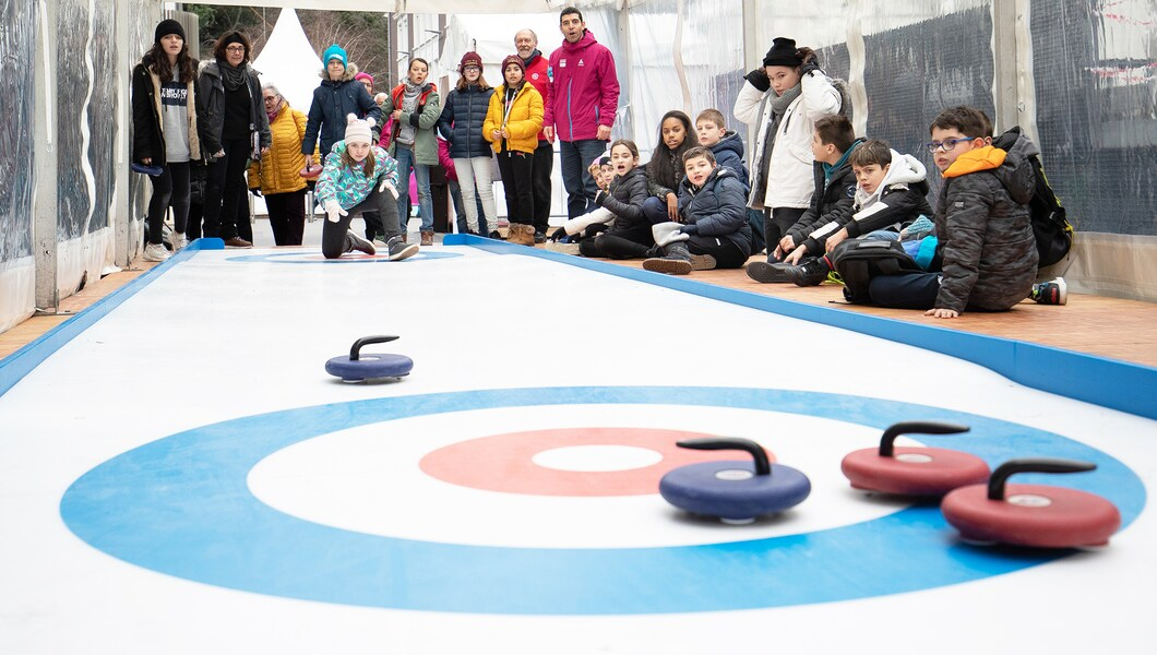 Kids observe curling competition