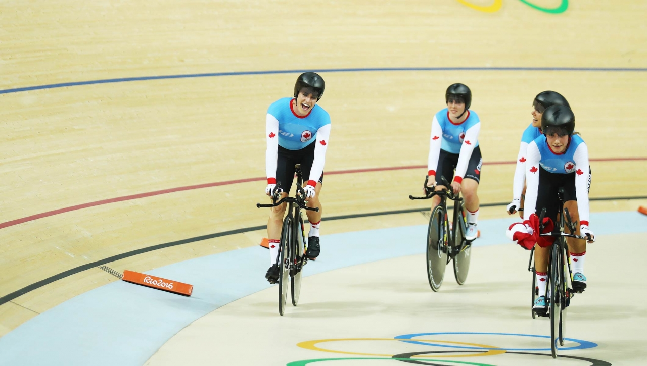 olympic bicyclists on track