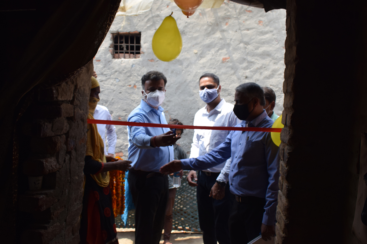 Rockwell's Chitrabhanu Ghosh, assistant general counsel (center left), and Ankit Singh, India EHS lead, (center right), at one of the home launch ceremonies.