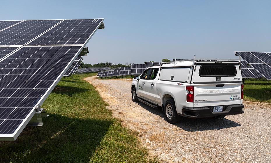 White pickup truck amongst solar field
