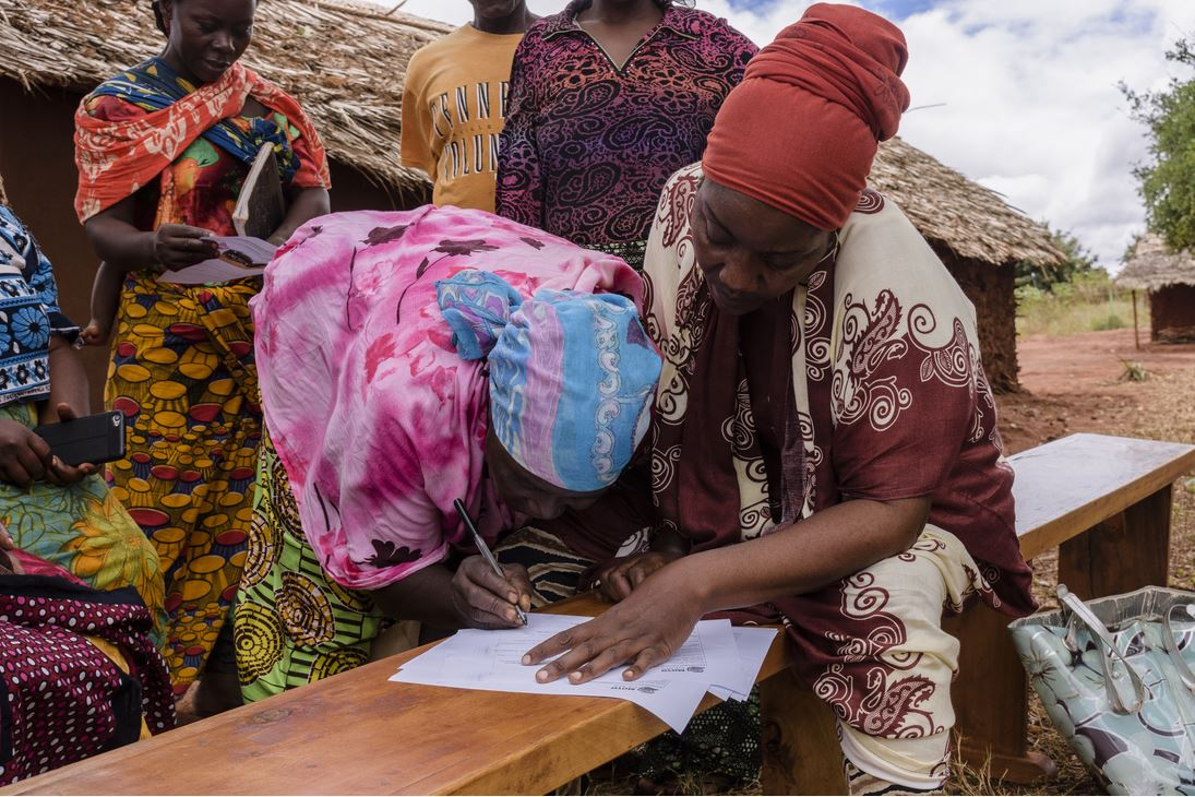 Salma Registering Moyo Miners. Photo: PACT.