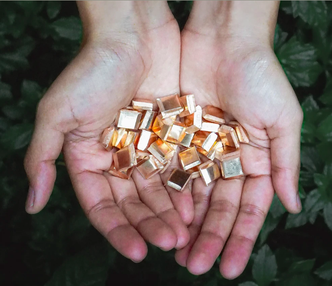 Cupped hands holding Impact Gold, a fully traceable gold artisanally mined in Peru by PX IMPACT® which created a sustainable, transparent supply chain that meets world leading standards for responsible practices through guaranteeing: Image: B.P. de Silva. https://bpdesilvajewellers.com/blogs/safekeeping-stories/introducing-impact-gold