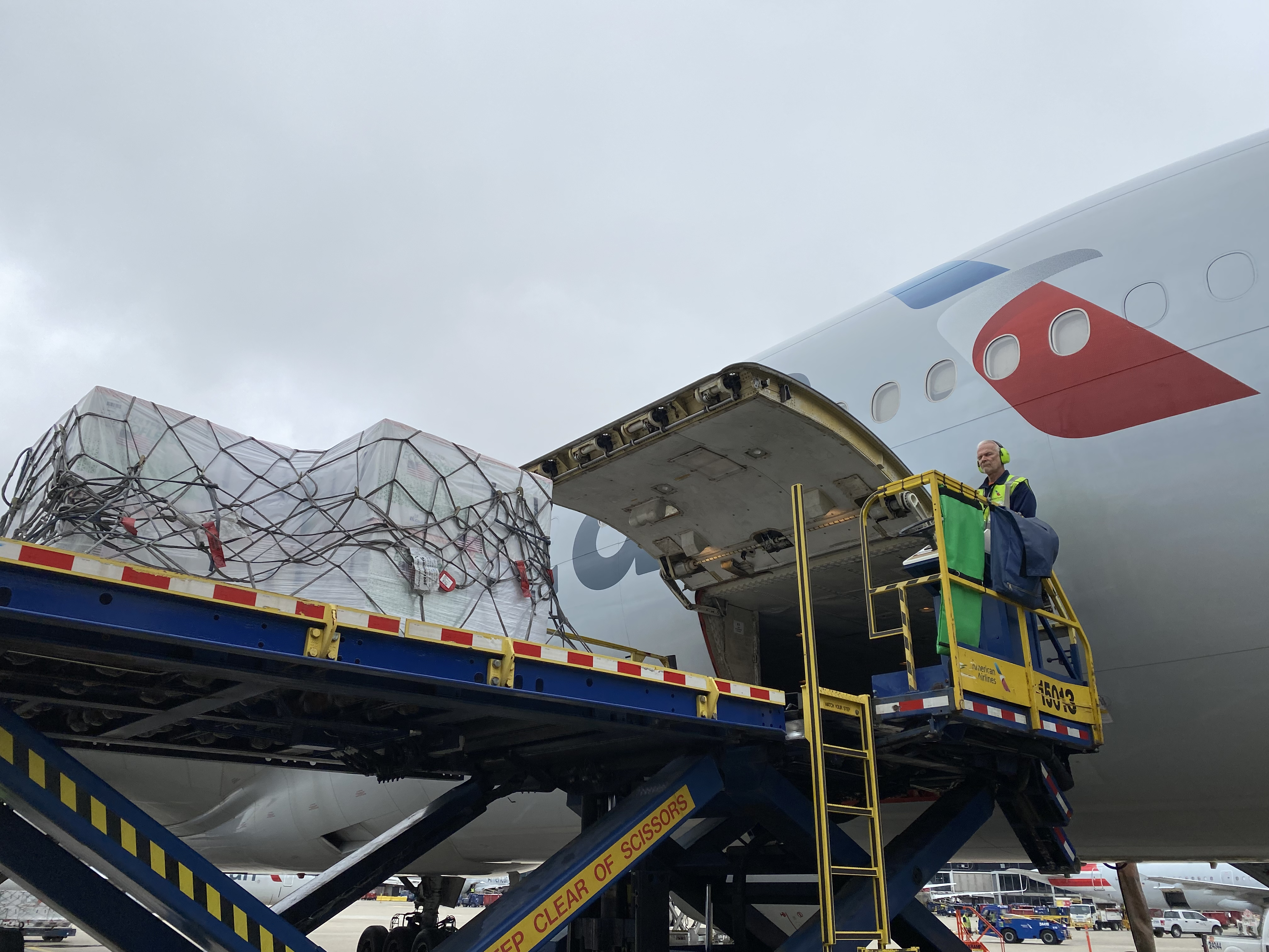 Cargo being loaded on Airplanes