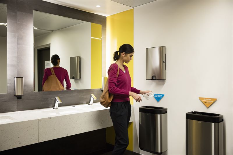 person in a public bathroom