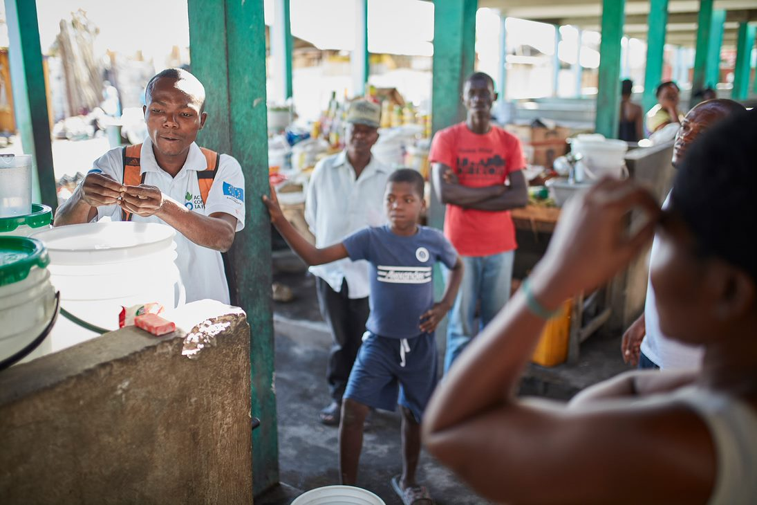 A community education session on water, sanitation and hygiene at a local market in Haiti