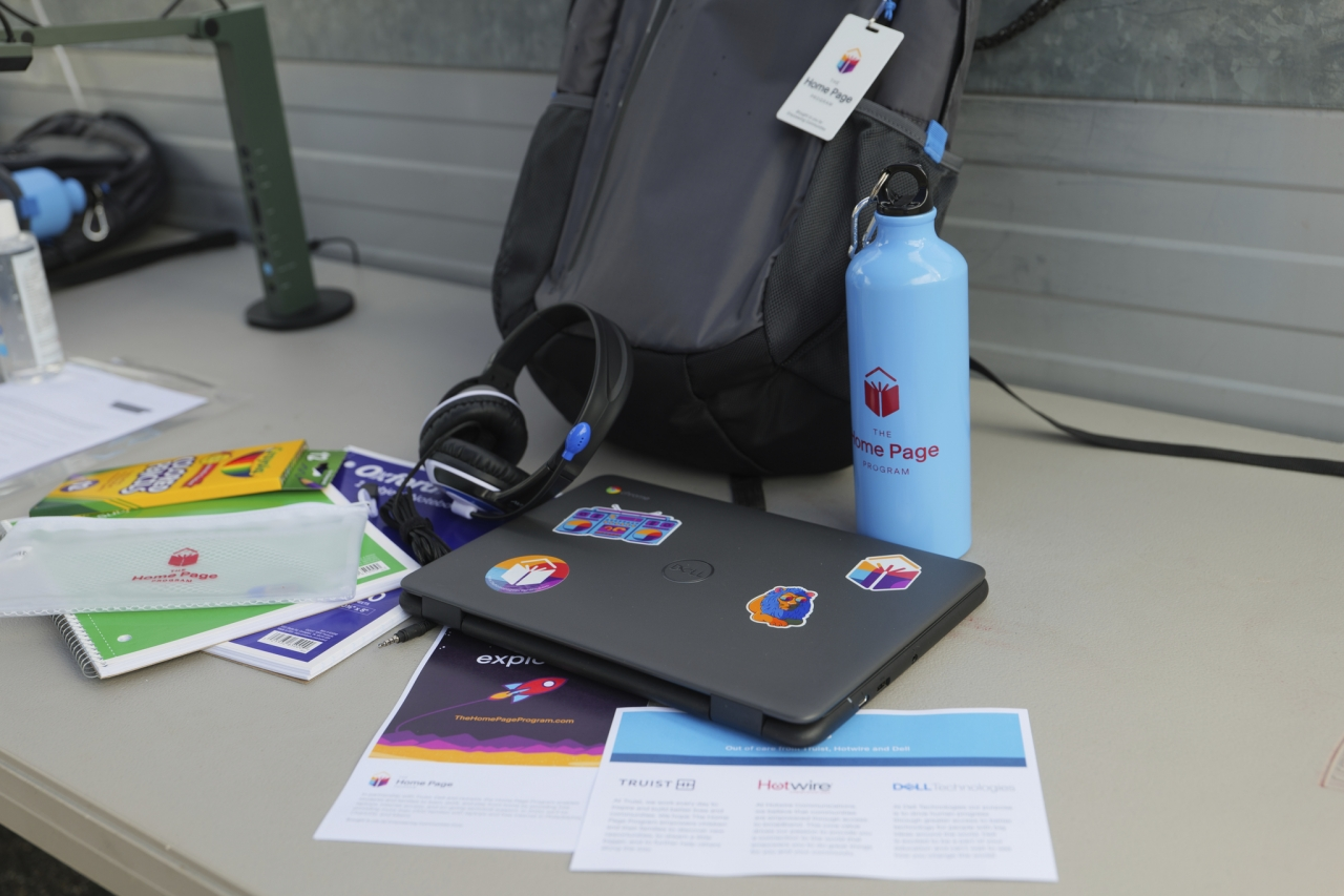 Backpack with water bottle, colored pencils, computer, and headset