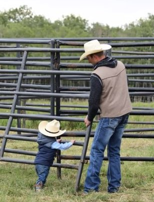 Father and child on farm