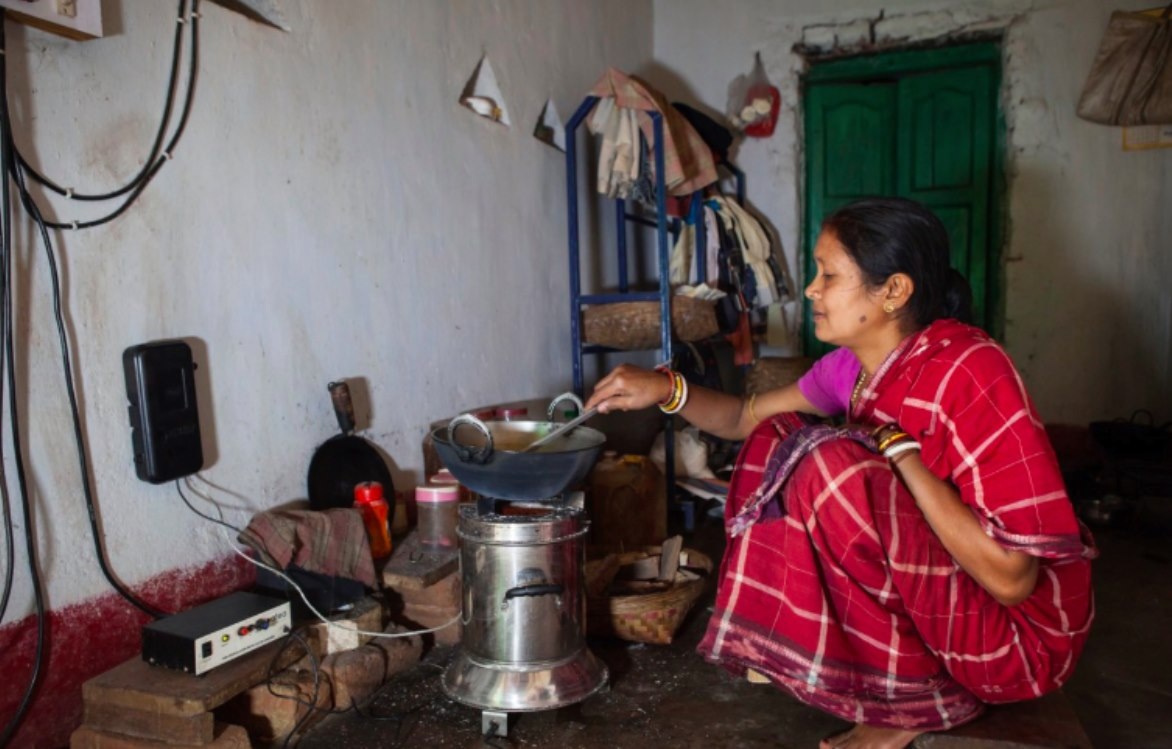 woman using clean cookstove