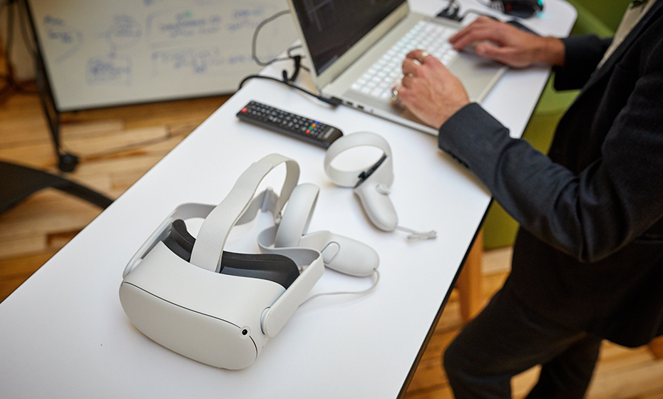 work desk with virtual reality googles on the desk