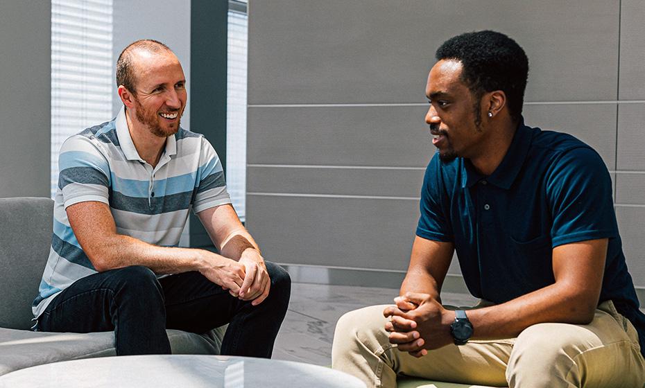 Jordan Howard, right, and his supervisor at Duke Energy, Daniel McIntyre.