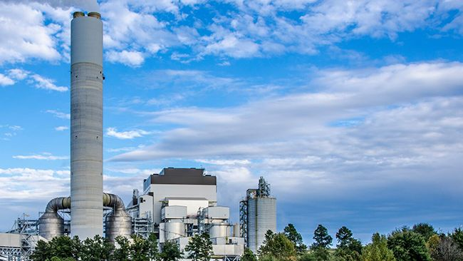 power plant against a blue sky