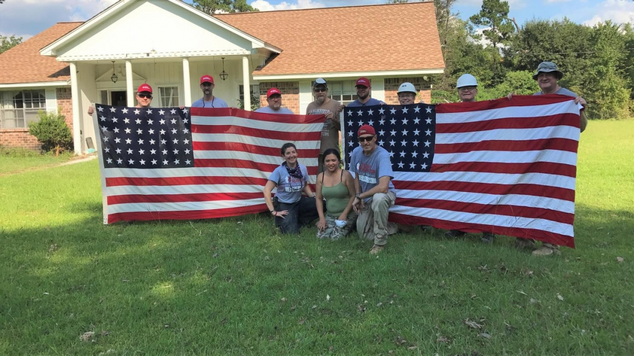 Bob leading a team on a muck out in Houston following Hurricane Harvey. The flags were cleaned on site by the volunteers and belonged to the owner's father and uncle, both veterans of WWII. Photo courtesy of Team Rubicon