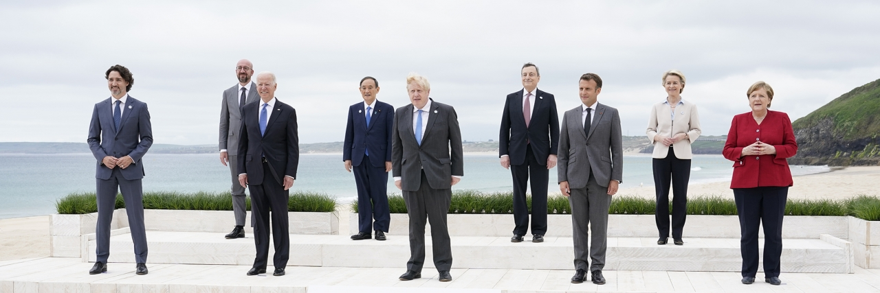 Leaders of the G7 pose for a group photo on overlooking the beach at the Carbis Bay Hotel in Carbis Bay, St. Ives, Cornwall, England, Friday, June 11, 2021. Patrick Semansky/Pool/AP
