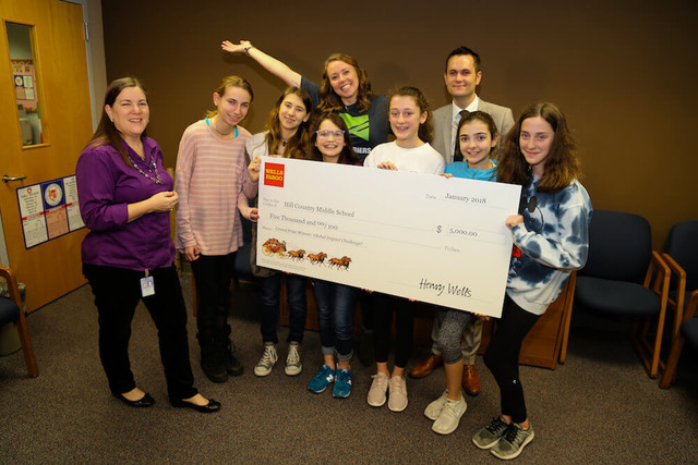 Students holding giant check