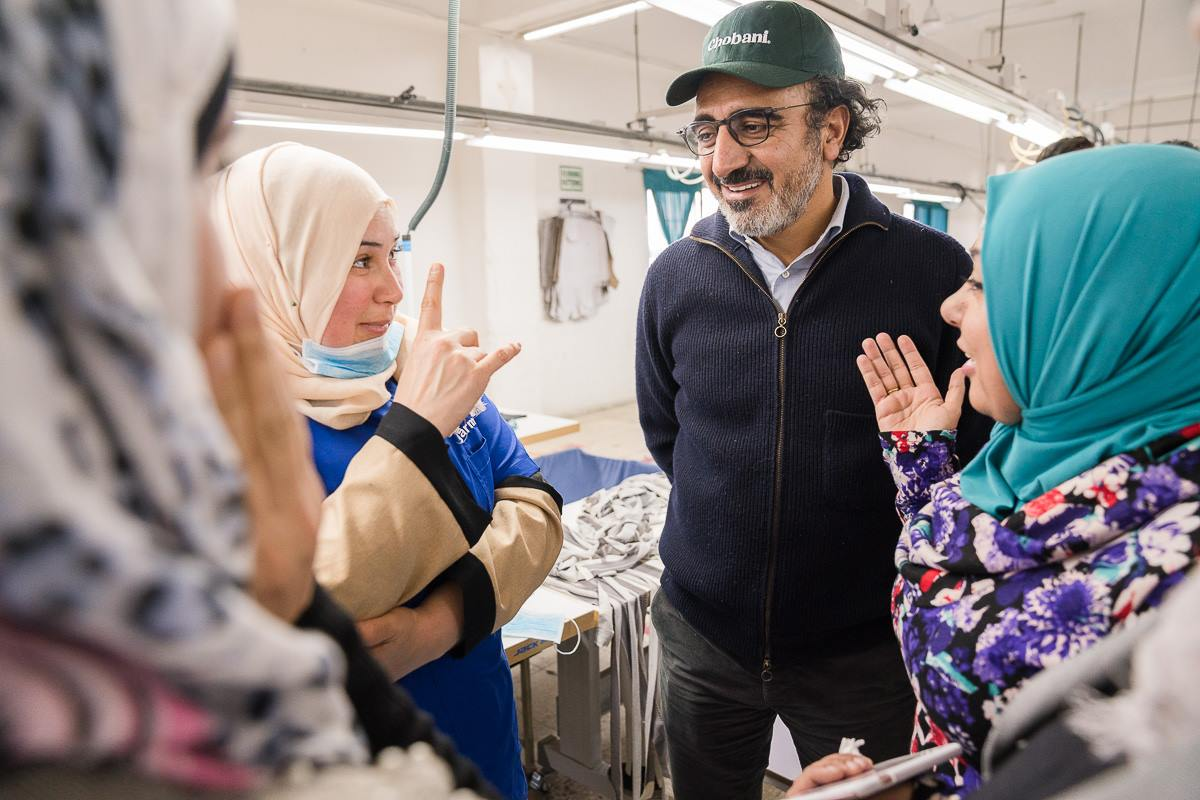Hamdi Ulukaya (2nd from right) of Chobani has long hired refugees.