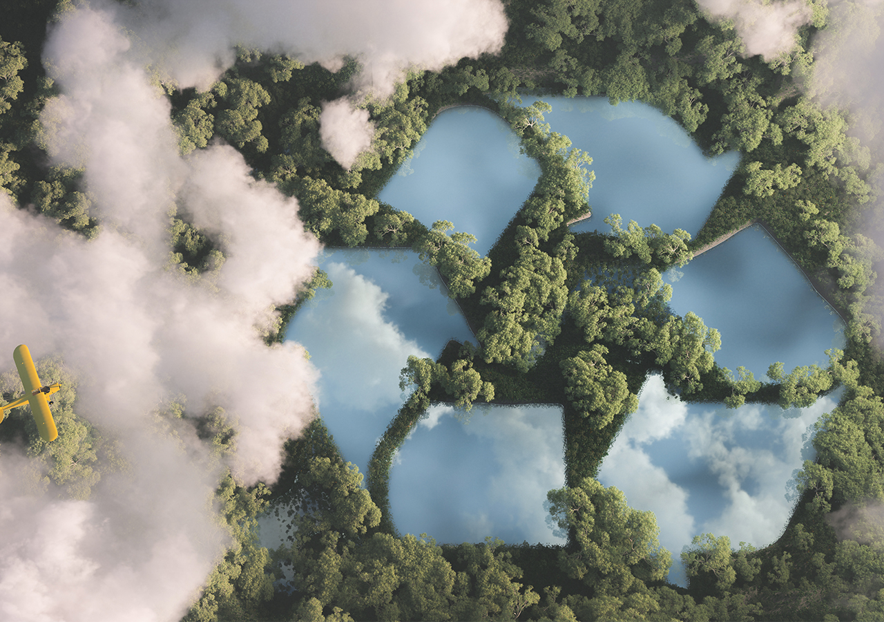 recycling logo embedded in a forest canopy, birds eye view
