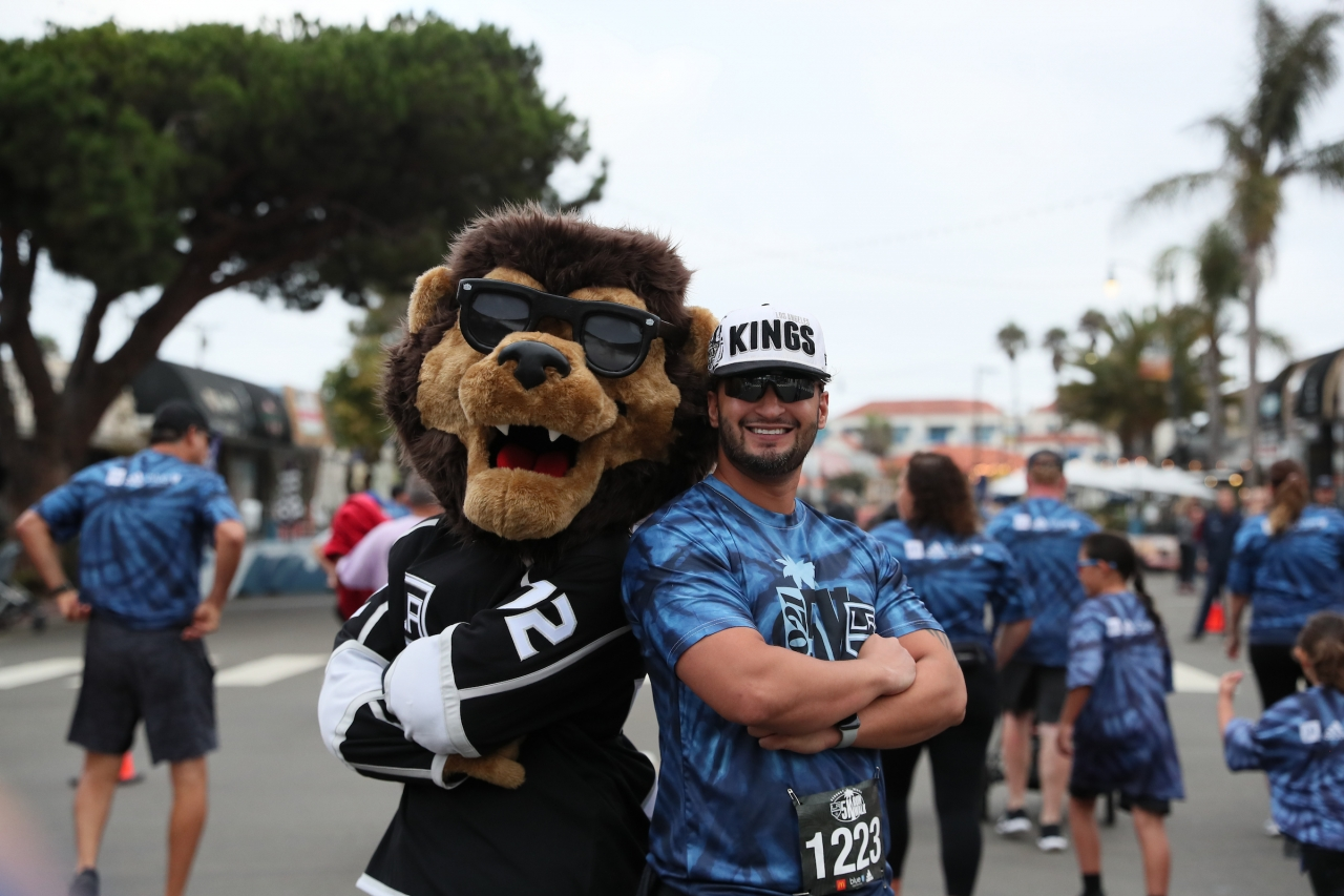 LA Kings mascot Bailey cheers on and poses with community members participating in the annual LA Kings 5K benefitting the LA Kings Care Foundation and Hydrocephalus Association on September 18, 2021 in Redondo Beach, Calif.