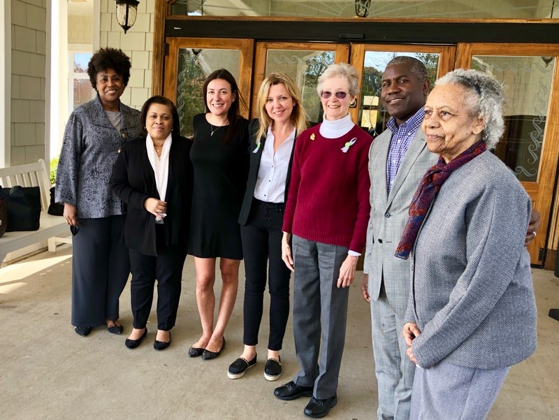 Martha Ulman, 3rd from right, with Spence-Chapin Leadership Team, including CEO, Kate Trambitskaya, 4th from right, and Board Chair, Ian Rowe, 2nd from right.