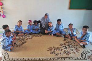 children sitting around a carpet