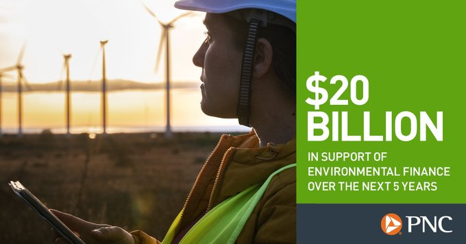"""Image of worker in front of wind turbines with text reading """"$20 Billion in support of environmental finance over the next 5 years."""""""