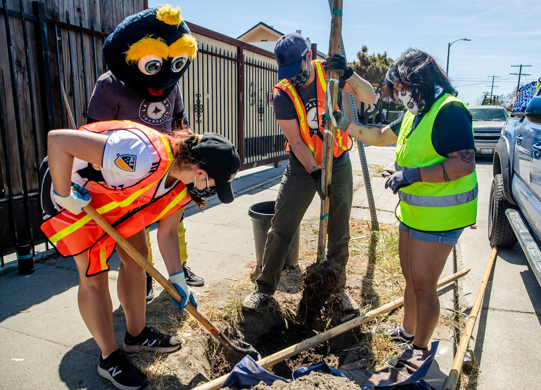 AEG and LA Galaxy staff team up with TreePeople to plant trees in a Watts neighborhood in Los Angeles with the help of LA Galaxy mascot in celebration of Earth Month