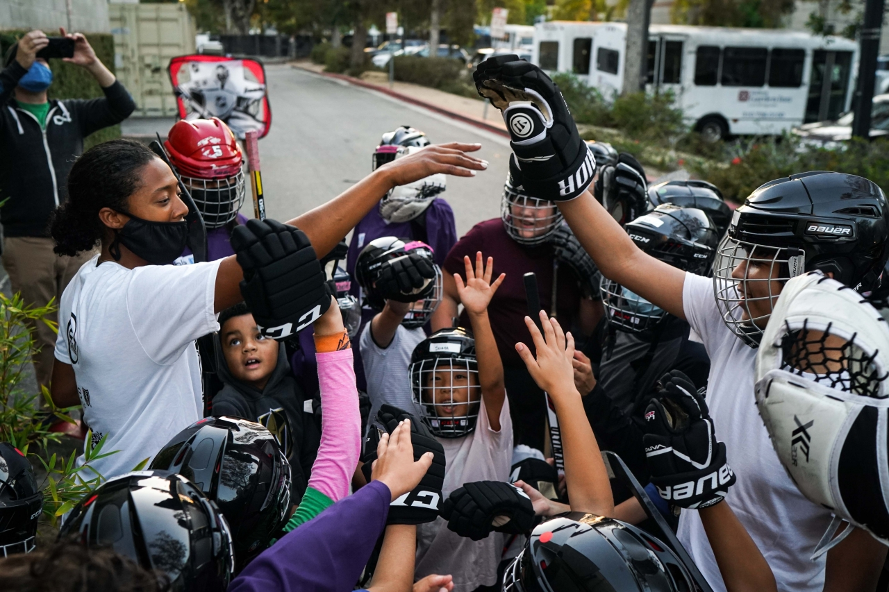 """A Kings' Blake Bolden, the club's AHL Scout and Growth and Inclusion Specialist – and the first Black professional women's hockey player after graduating college – coaches 30 youth during the LA Kings' first """"We Are All Kings Camp"""" at Toyota Sports Performance Center in El Segundo on August 2-7, 2021."""