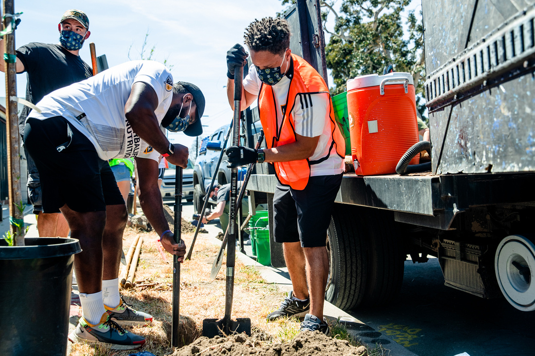 LA Galaxy and MLS star Cobi Jones works alongside LA Galaxy staff and supporters to plant trees in a Watts neighborhood in Los Angeles in conjunction with TreePeople for Earth Month