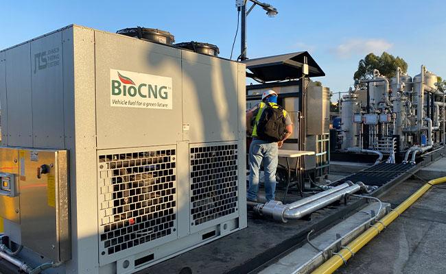 worker with BioCNG machine