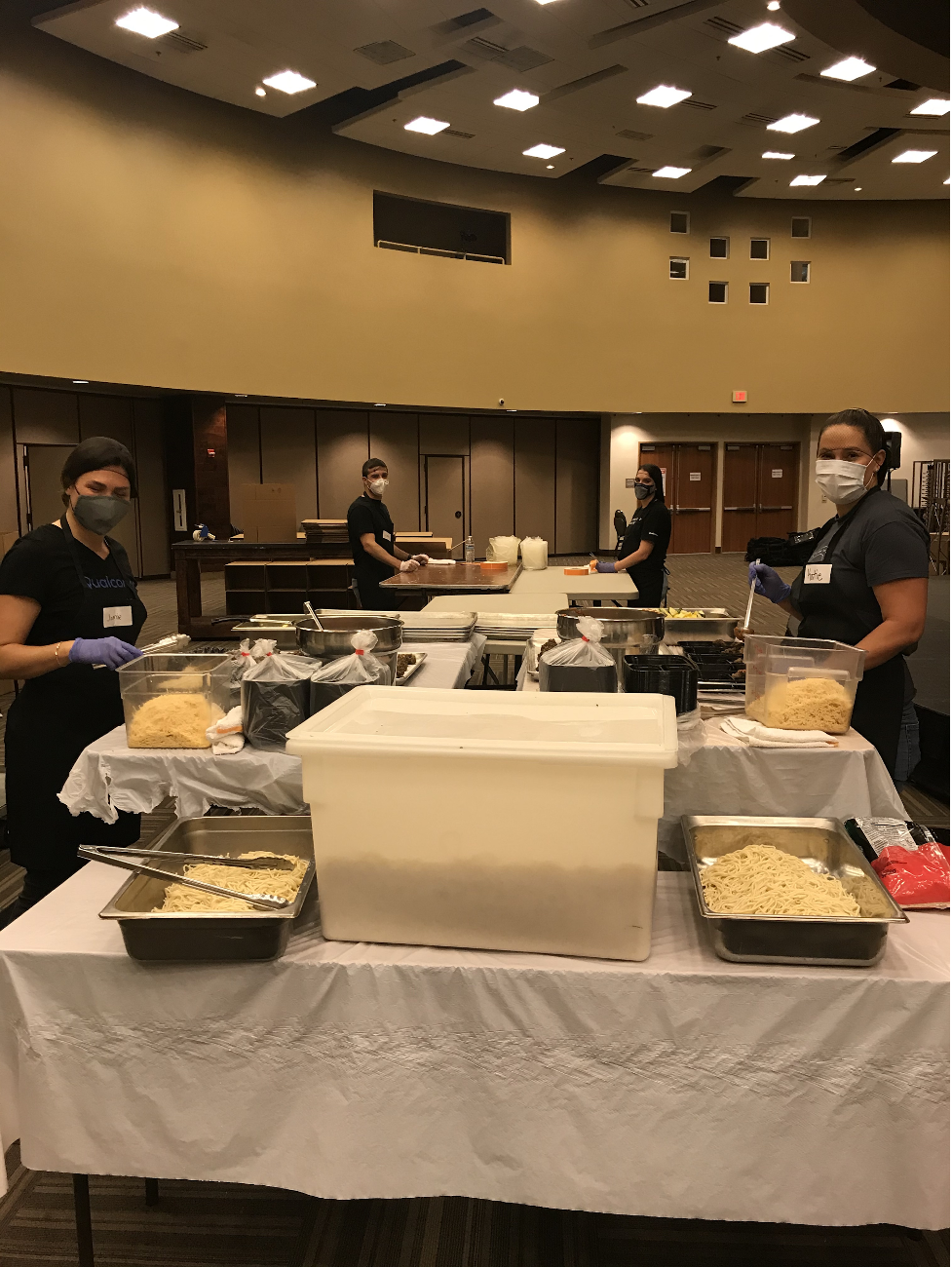 Image of volunteers wearing masks and cooking food