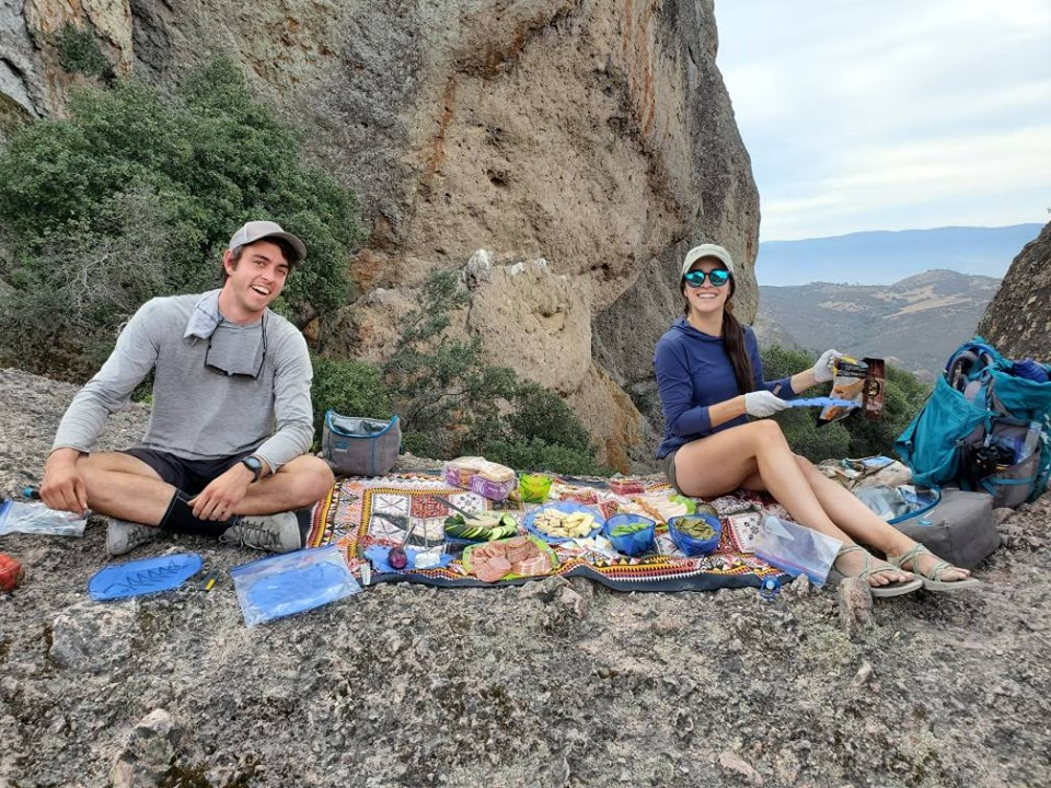 REI guides prepare a lunch spread in the middle of Pinnacles National Park