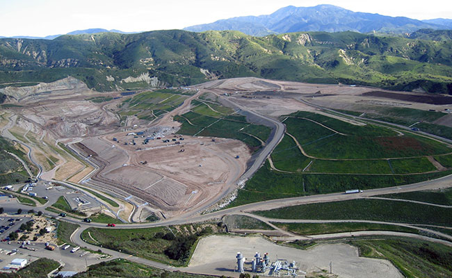 Image of rolling hills surrounding industrial facilities
