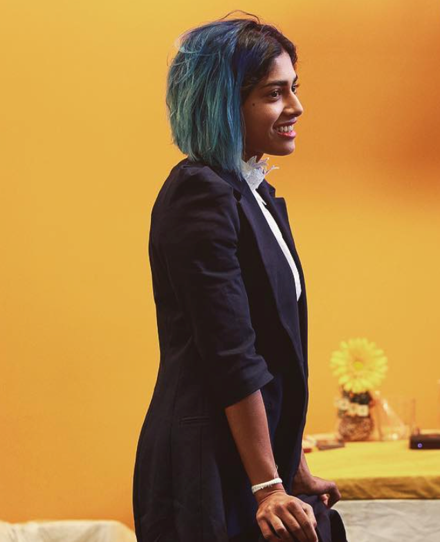 image of a businesswoman standing in a yellow room