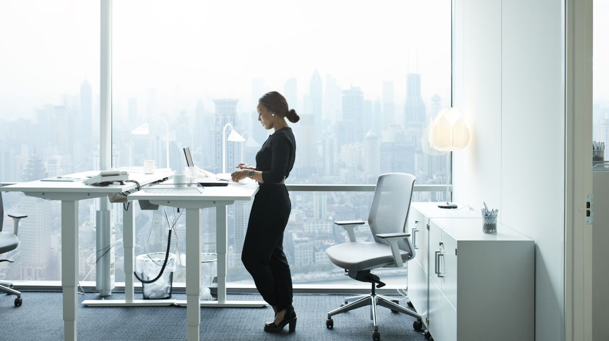 office worker standing at her desk
