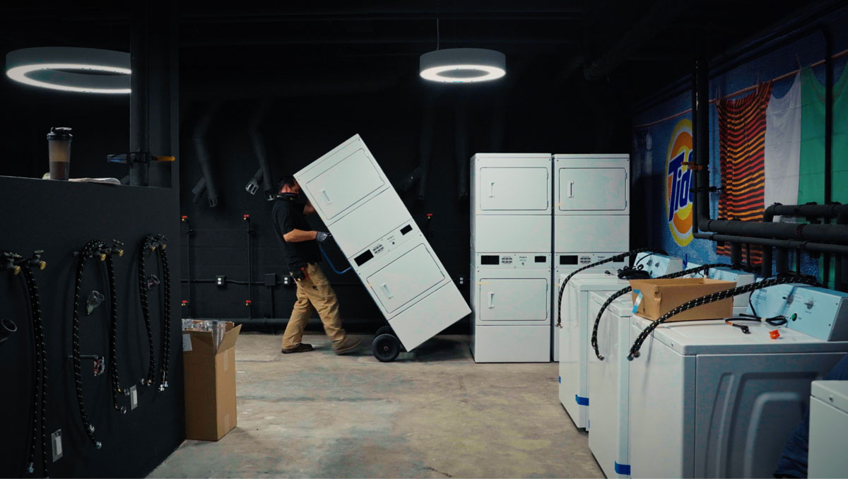 Person loading washing machines in a warehouse