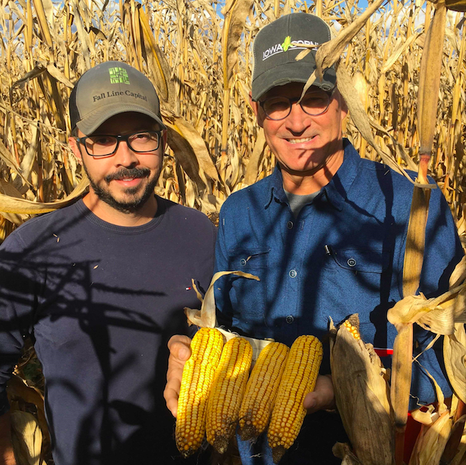 Bill Niebur (pictured right) with one of his non-GMO grower partners, Thiago Lima.