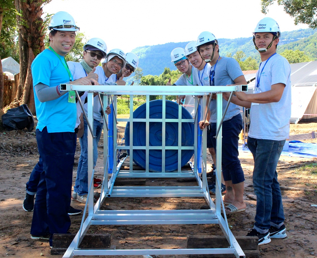Team in Laos building a water tower