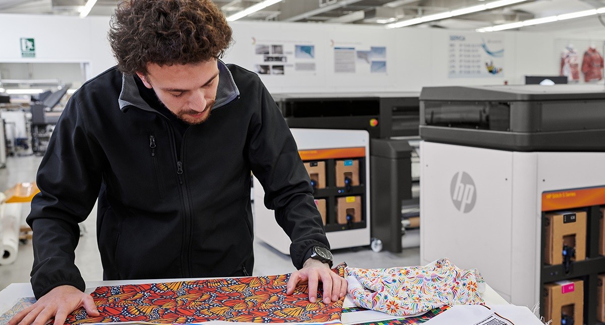 a person looking down at prints and patterns
