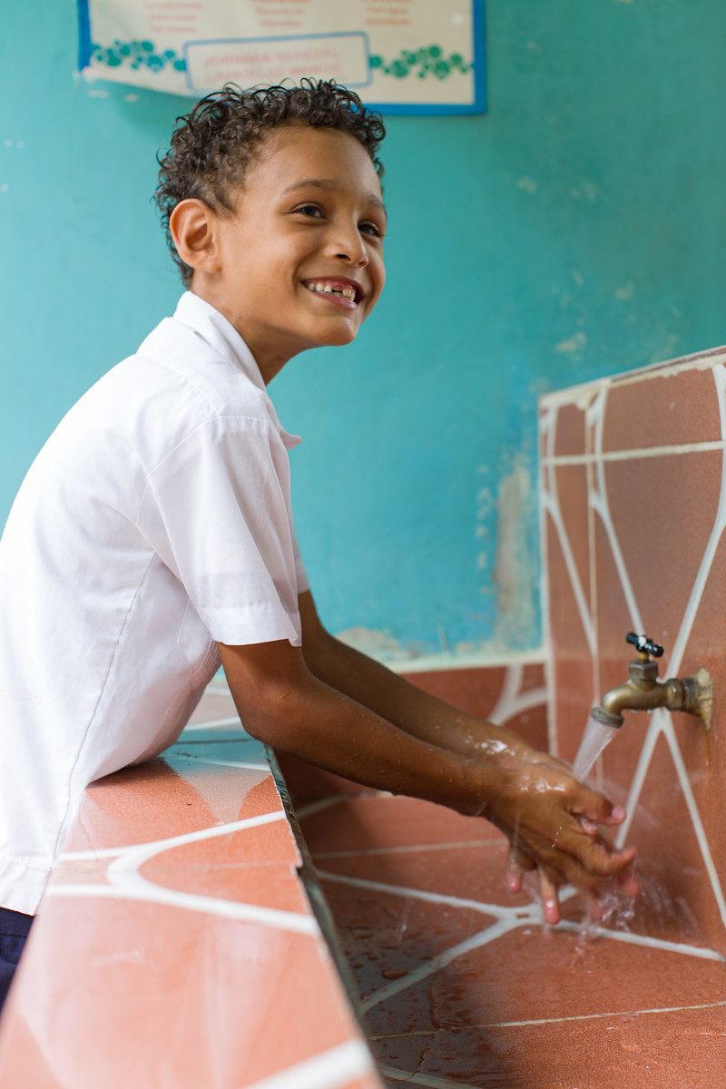 A young boy in Honduras now has water at his school. Photo credit: Water For People