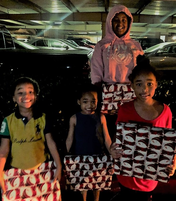 The Williams family, ages 6 to 13 receiving C2K laptops for Christmas to help them with their studies at Silver Wing Elementary School and Montgomery Middle School in San Diego.