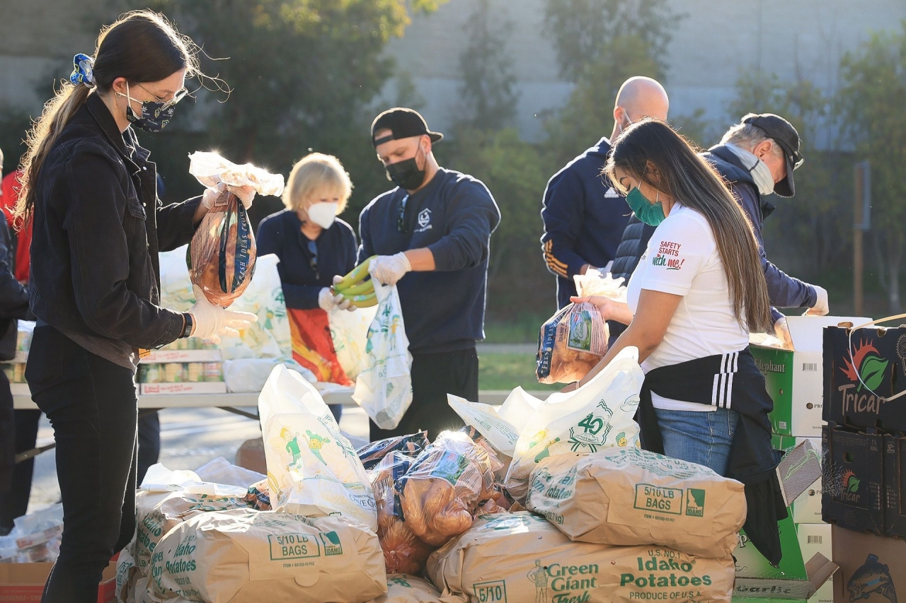 Volunteers assemble grocery bags to help vulnerable students at LA Harbor College's Spring Food Distribution event