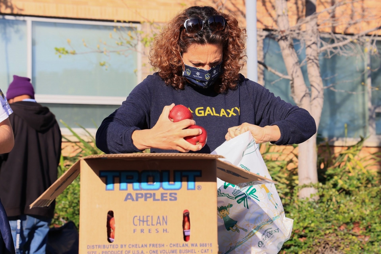 LA Galaxy volunteers pack grocery bags to help more than 350 vulnerable students during LA Harbor College's Spring Food Distribution event