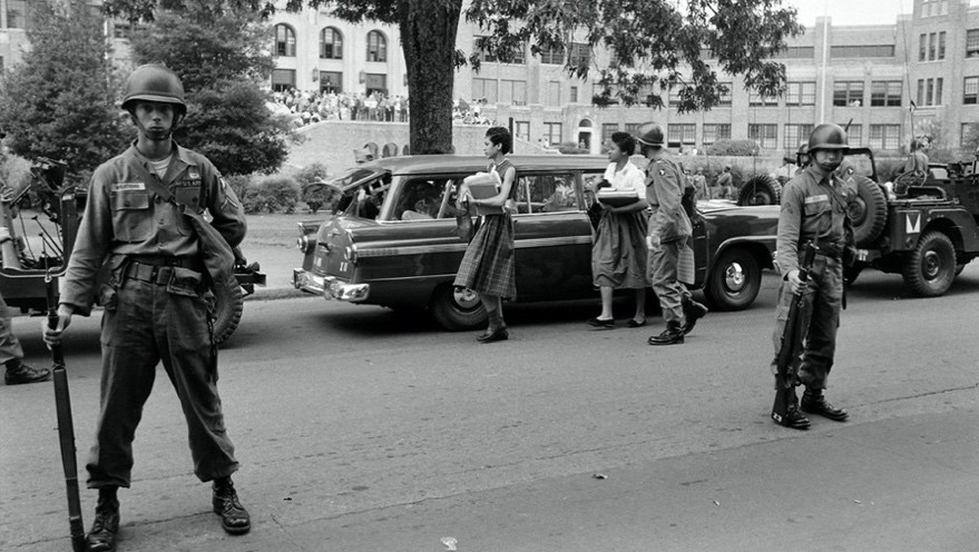 The Arkansas National Guard escorts Carlotta Walls LaNier and a fellow member of the Little Rock Nine on the grounds of Little Rock Central High School, September 1957. (Ed Clark/The LIFE Picture Collection via Getty Images)
